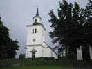 Sköns kyrka med omgivande kyrkogård, vy från väster.