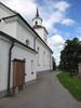 Sköns kyrka med omgivande kyrkogård, vy från nordöst.